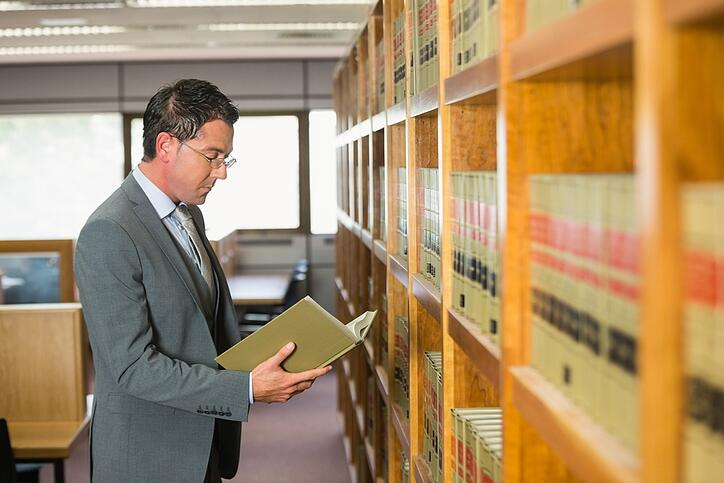 Lawyer reading book in the law library at the university.jpeg